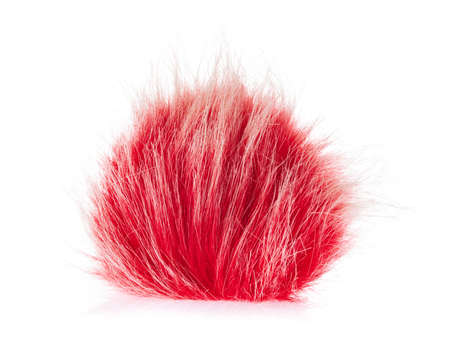 Red fur ball isolated on white background
