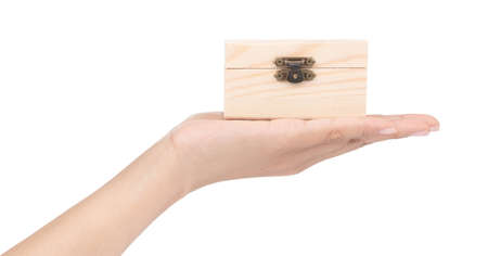 hand holding wooden of chest isolated on white background