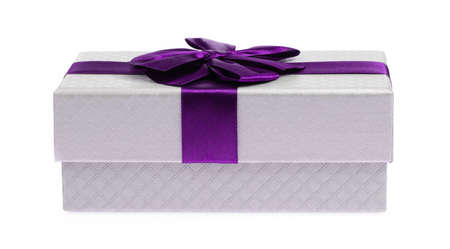 Gift color silver box with purple ribbon and bow isolated on white background Stock Photo