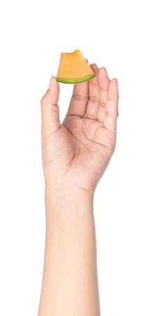 hand holding Sliced Cantaloupe melon Isolated on White Background
