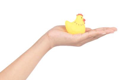 hand holding Plastic Toy Animal isolated on white background