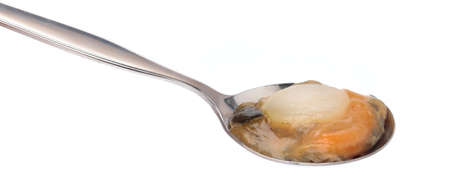 spoon of Raw scallops Isolated on white background. Stockfoto