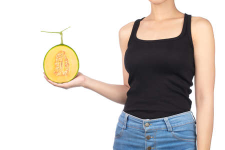 young woman holding half of Cantaloupe melon isolated on white background.