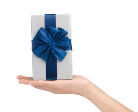 hand holding a Gift color silver box with blue ribbon and bow isolated on white background 版權商用圖片