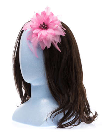 beautiful a flower on mannequin head isolated on white background 写真素材