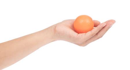 hand holding fruit toy plastic isolated on white background Reklamní fotografie