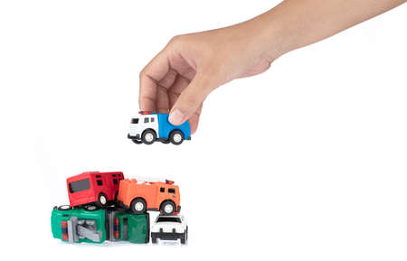 hand holding car toy kids isolated on a white background. Stok Fotoğraf