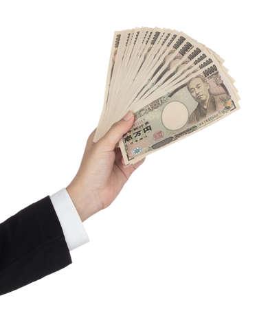 Businesswoman giving money and holding 10,000 japanese yen money Isolated on white background