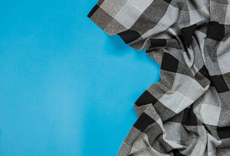 black checkered tablecloth on blue background