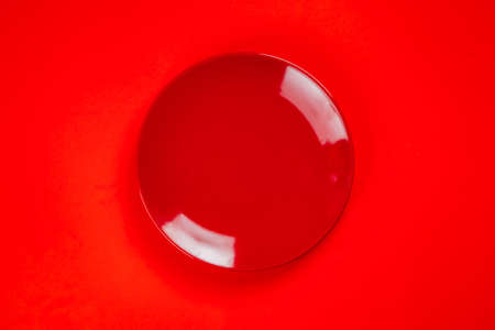A red plate on red background