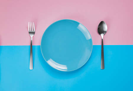 Blue dish on a pink and blue background