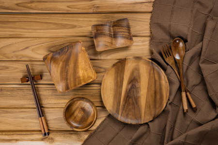 Collection of kitchenware with tablecloth on a wooden background