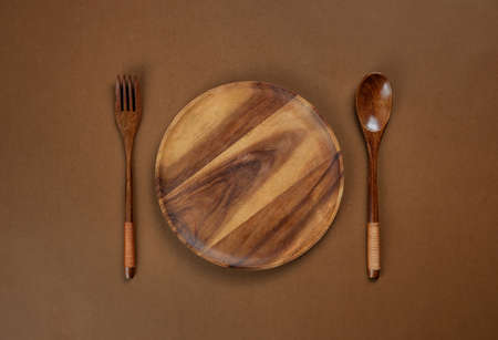 A wood plate on brown background