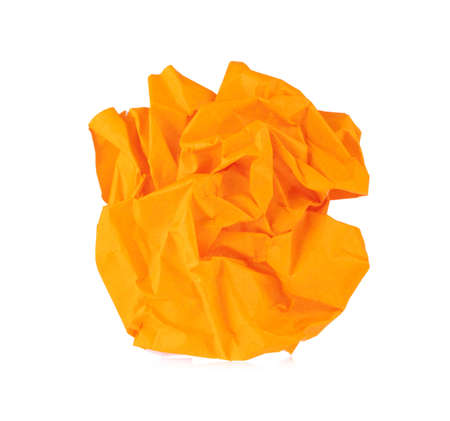 Crumpled up piece orange of Paper isolated on white background