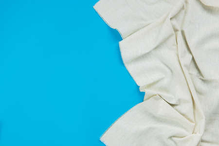 White tablecloth on blue background Imagens