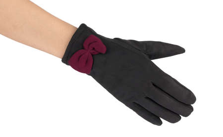 Beautiful black women's gloves in hand isolated on white background Imagens