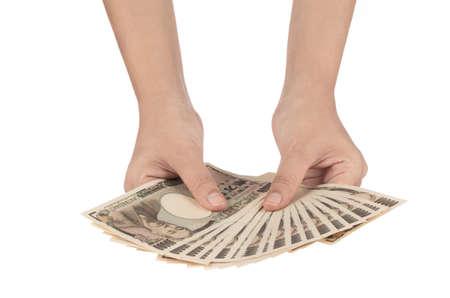 japanese yen money in hand isolated on white background Stock Photo