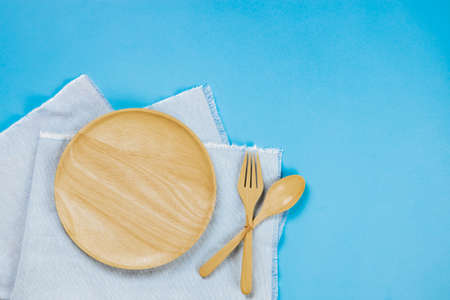Kitchenware set with with tablecloth on blue background