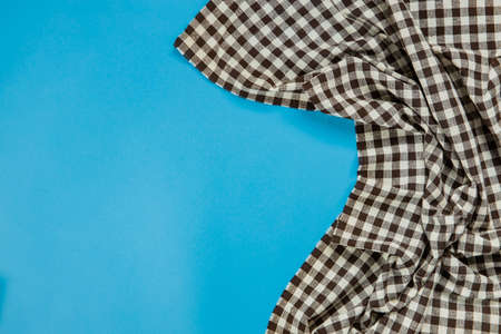black checkered tablecloth on blue background 스톡 콘텐츠