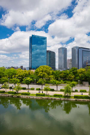 Osaka, Japan - May 10, 2018 :view of Modern office building with the trees and river in Osaka, Japan