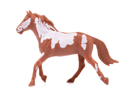 Toy horse made of plastic isolated on white background
