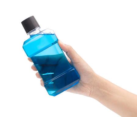 hand holding blue water mouthwash isolate on white background
