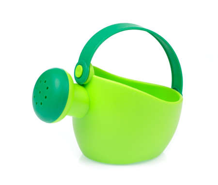 plastic watering can isolated on a white background.