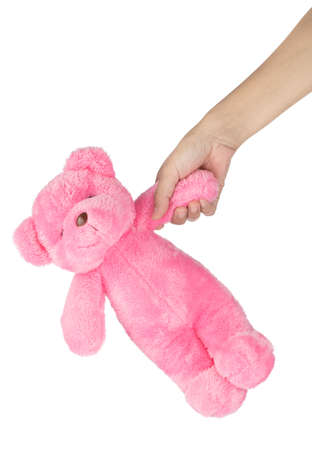 hand holding lovely pink teddy bear isolated on white background Stockfoto