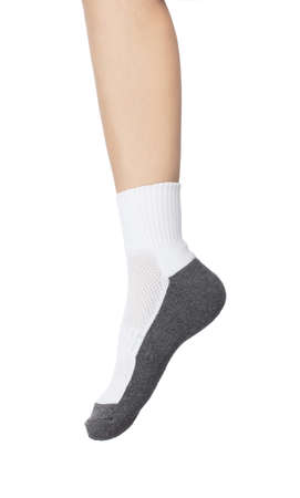beautiful human foot dressed in new nice and soft cotton fabric blank sock isolated on a white background.