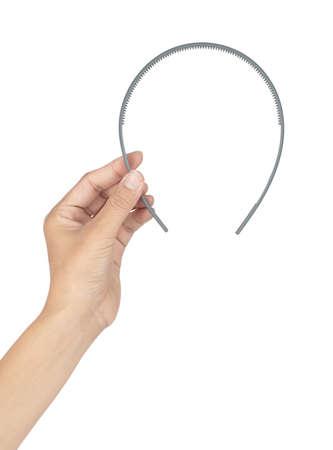 Hand holding Plastic Hair Headband isolated on white background