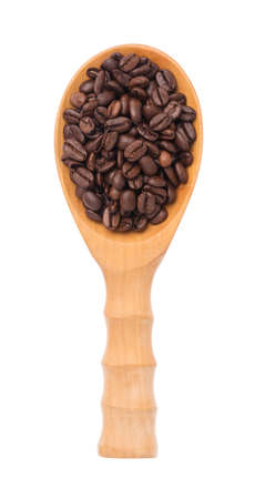 roasted coffee beans on wood ladle isolated on white background