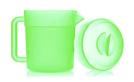Green plastic pitcher isolated on white background Standard-Bild - 150260740