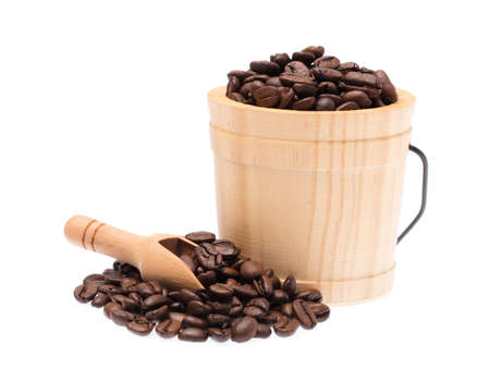 wood cask and ladle with roasted coffee beans isolated on white background