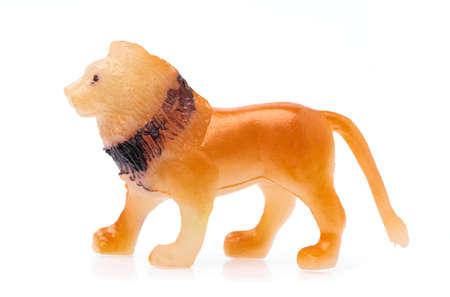 plastic lion isolated on white background Imagens