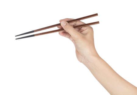 hand holding chopsticks isolated on white background