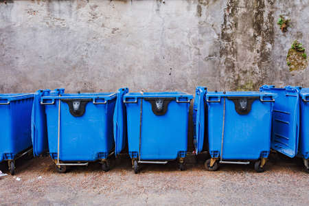 Big blue plastic garbage container with wheel
