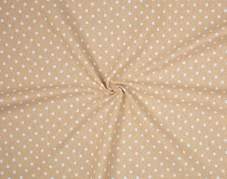 Brown polka dot fabric in full frame Imagens