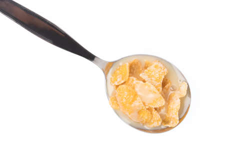 Cereal on spoon isolated on white background. Stock Photo
