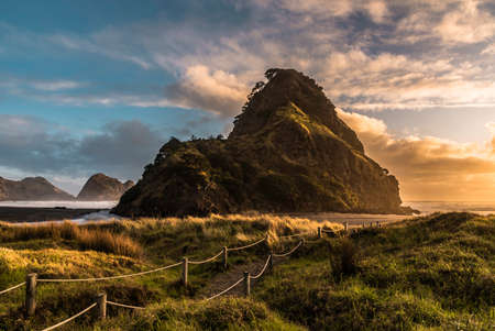 Sunset at Piha beach, Auckland, New Zealand