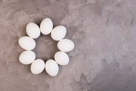 White Easter eggs on grey marble table. Copy space. Stock Photo