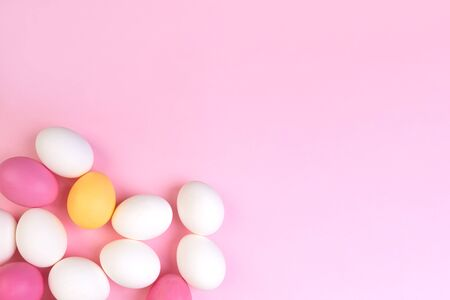 Beautiful banner with color easter eggs. Food event concept. Bright festive decor. Colorful pink background. Flat design with copy space. Stock Photo