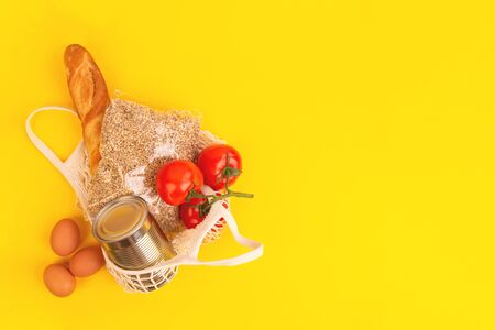 Food packaging on yellow background. Quarantine food delivery home. Flatlay banner with copyspace.