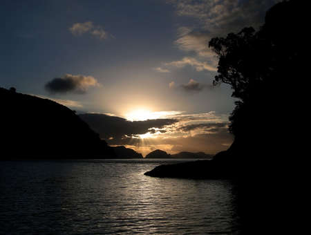 barrier island: Setting sun from Great Barrier Island, New Zealand Stock Photo