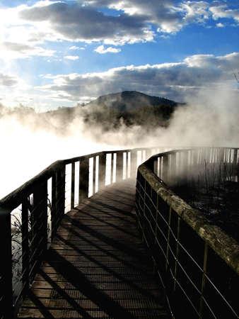 Wooden walkway through geothermal steam  in Kuirau Park, Rotorua, New Zealand