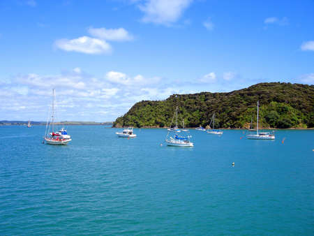 Boats anchored near Russell in the Bay of Islands, New Zealand photo