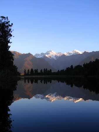 Mount Cook and Mount Tasman reflected in Lake Matheson, New Zealand photo