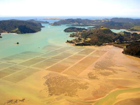 motu: Aerial view of ocean agriculture in Whangaroa Harbour, Northland, New Zealand