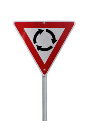 Roundabout Warning Sign - Current Australian Road Sign for left-hand traffic (reflective). Isolated on White photo