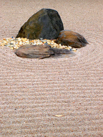 evoke: Karesansui - Japanese dry rock garden intended to evoke mountains surrounded by water.