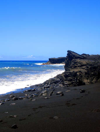 island: Footsteps along Kaimu Black Sand Beach, The Big Island, Hawaii
